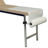 Paper roll holder for examination couch